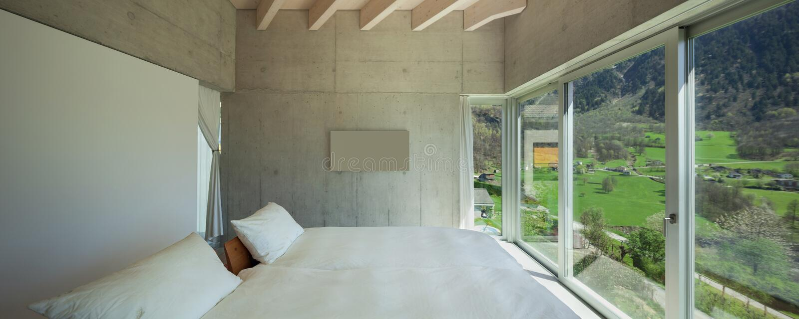 Modern chalet, bedroom stock photography