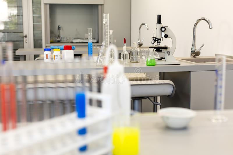 Modern chemistry lab with equipment. Contemporary, flask, glass, microscope royalty free stock images