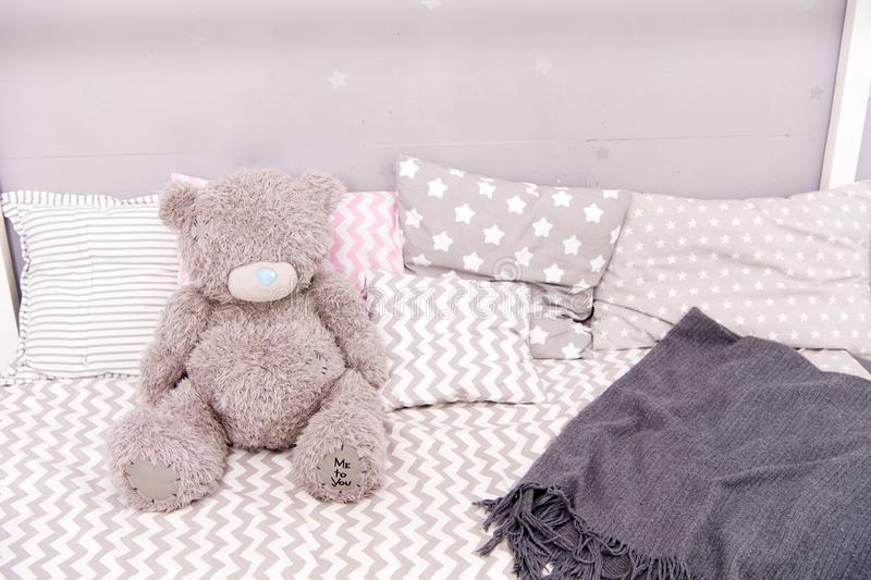 Modern child room interior with comfortable bed. bear toy on bed. girls bedroom. Children bedroom interior. Inside royalty free stock photography