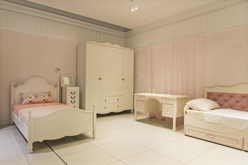 Modern children's furniture in a spacious bedroom stock image