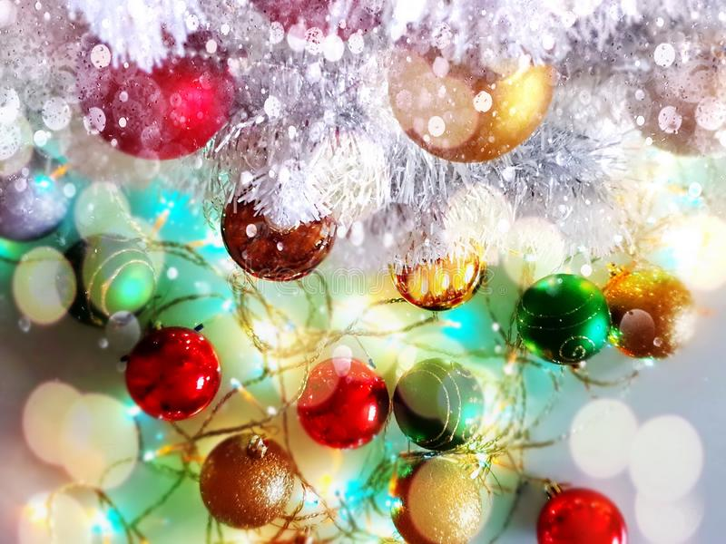 Christmas tree holiday white gold silver red green balls with snowflakes wallpaper light decoration lights colorful new year blurr. Modern Christmas tree holiday royalty free stock photo
