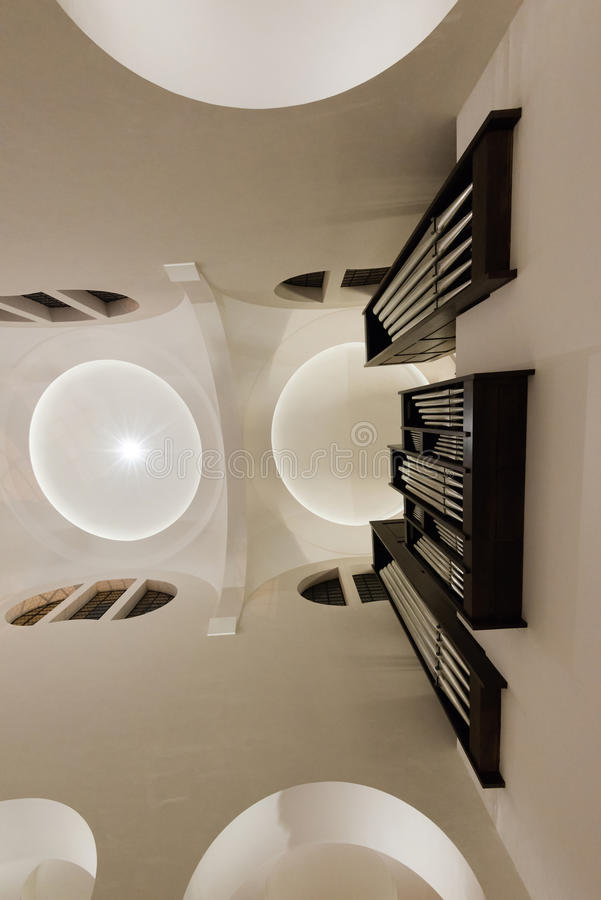 Modern Church interior. Modern white church interior with lights and organ stock photo