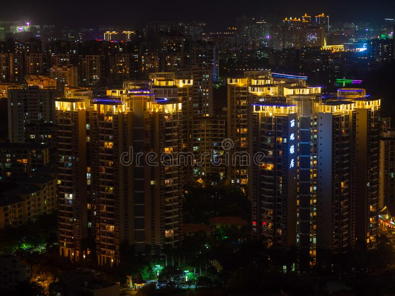 Modern city aerial. Building of modern city at night, lighted windows view royalty free stock photography