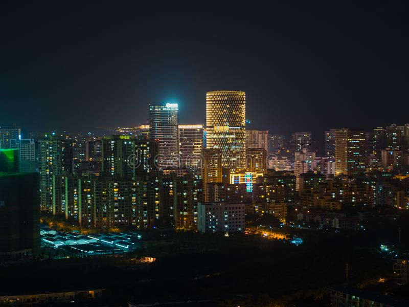 Modern city aerial. Building of modern city at night, lighted windows view stock image