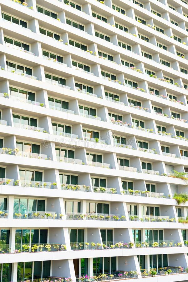 Modern city building exterior with many rooms with balconies. As cells stock photography