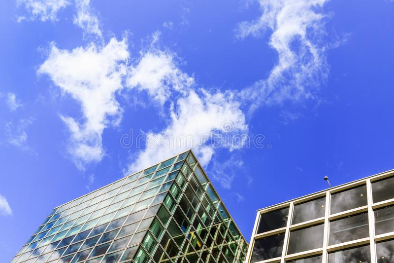 Modern city buildings exterior design, glass facades. Exterior of Van Gogh Museum is an art museum in Amsterdam, Netherlands. royalty free stock photo