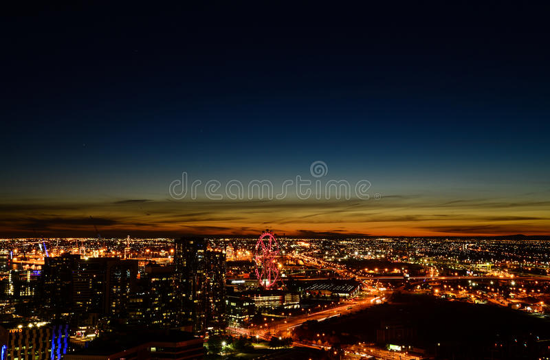Modern city buildings in night. Arial view of CBD buildings at night in Melbourne,victoria in Australia including docklands and ferris wheel royalty free stock photo