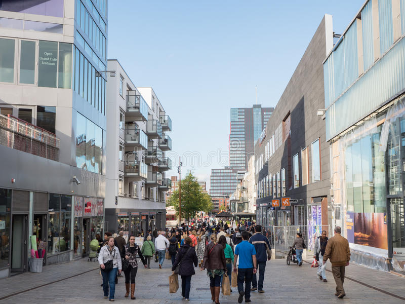 The modern city centre of Almere, The Netherlands. ALMERE, NETHERLANDS - 26 OCT. 2013: People shopping in the modern city centre of Almere, Flevoland, the royalty free stock image
