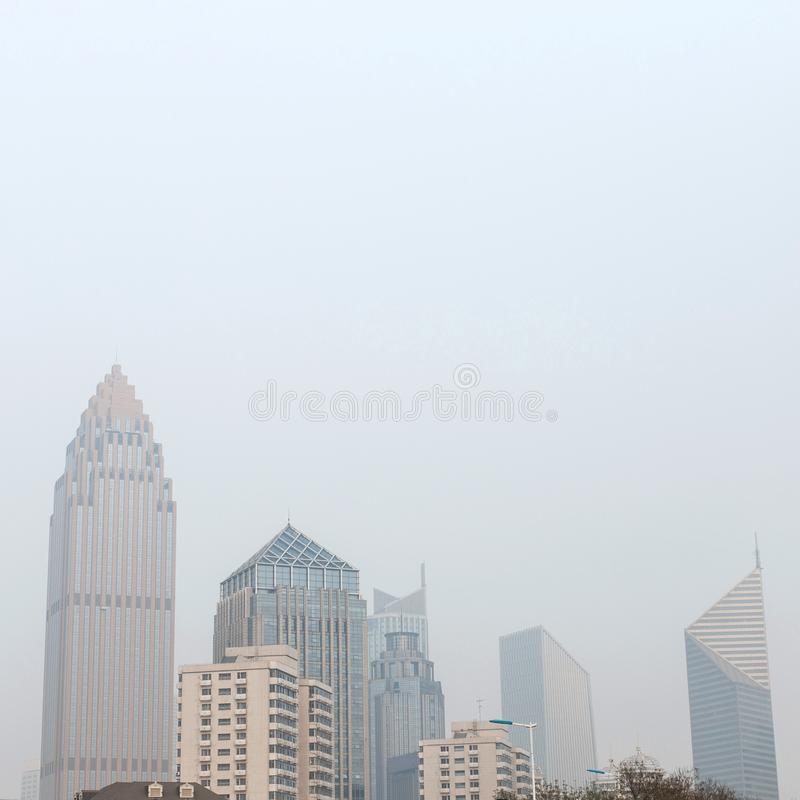 Modern city, Chinese skyscrapers on a background of environmental pollution. Street stock photos