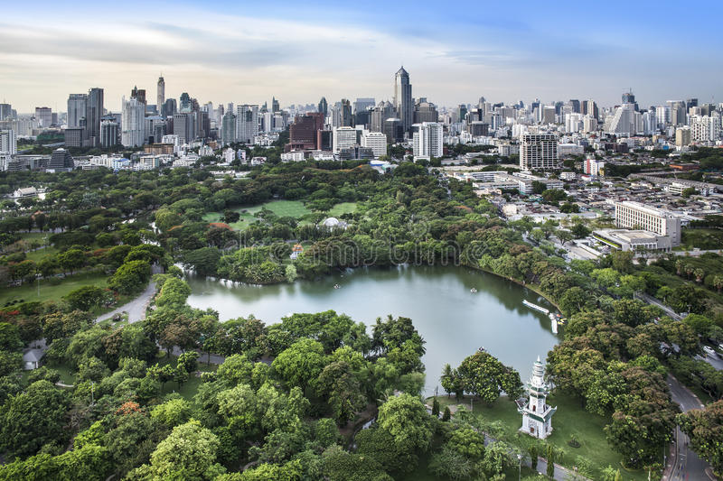 Modern city in a green environment, Suan Lum, Bangkok, Thailand. royalty free stock image