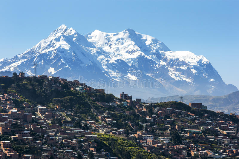 The modern city of La Paz in Bolivia overshadowed by Illimani. royalty free stock photography