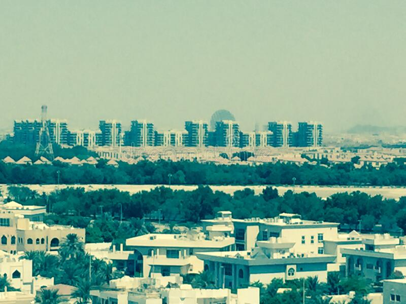 A modern city in the middle of the desert. Large modern houses on the horizon. royalty free stock image