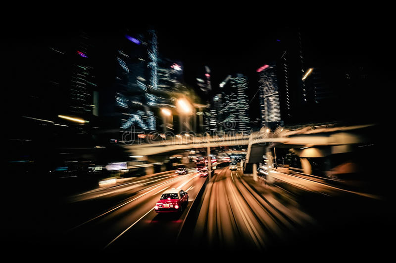 Modern city motion blur. Hong Kong. Abstract cityscape traffic. Moving through modern city street with illuminated skyscrapers. Hong Kong. Abstract cityscape royalty free stock image