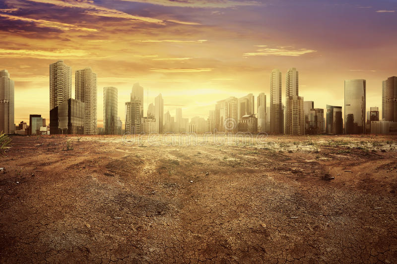 Modern city showing the effect of climate change. Impact to the dry land royalty free stock image