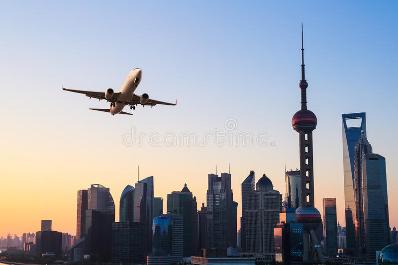 Modern city skyline with airplane royalty free stock photography