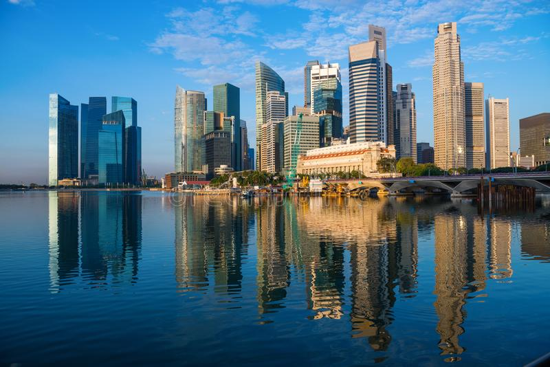 Modern city skyline with high skyscrapers. In dark blue colors on Singapore Marina Bay waterfront at early sunrise morning time royalty free stock photos