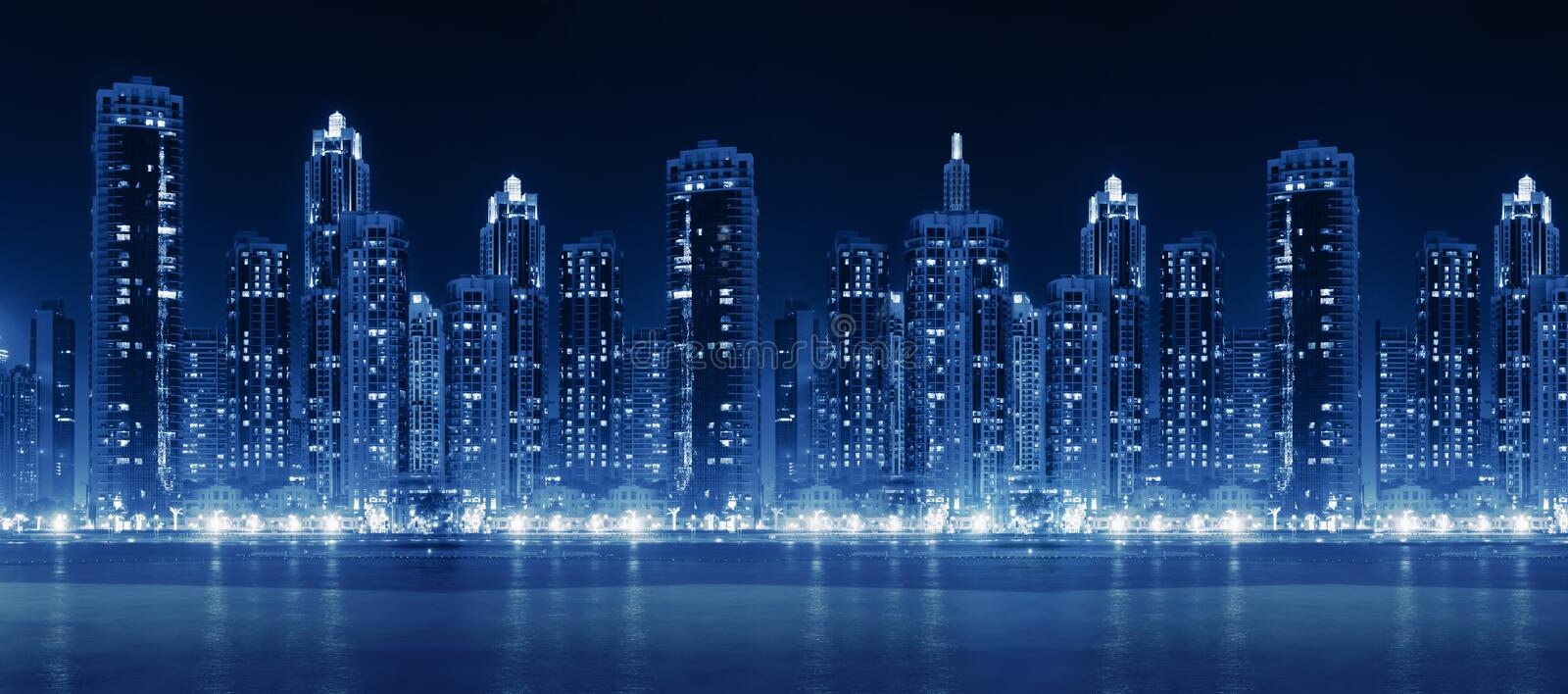 Download Modern City Skyline At Night With Illuminated Skyscrapers Stock Photo - Image of metropolitan, harbor: 44805884