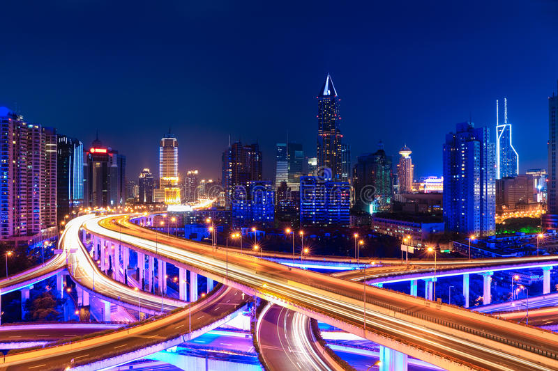Modern city skyline with interchange overpass at night royalty free stock images