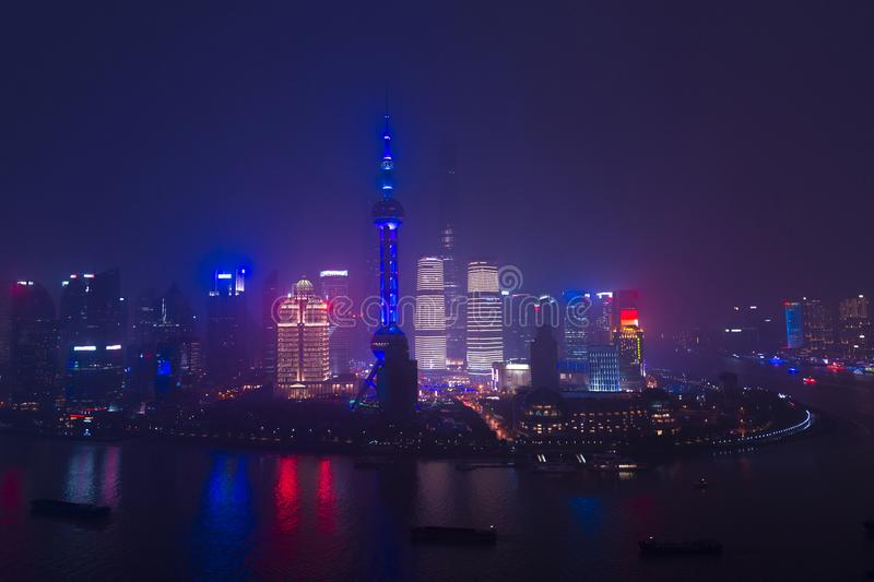 Modern city skyscrapers of Shanghai skyline at night with reflec stock image