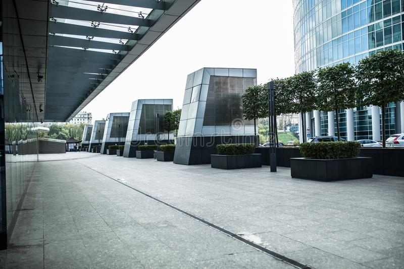 Modern city street footpath with glass windows wall and sunlight. With nobody royalty free stock photography