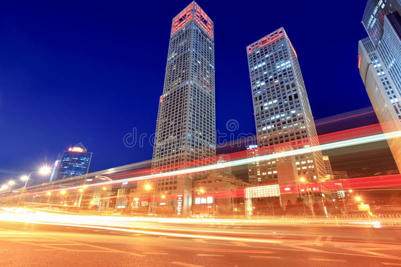 Modern cityscape with traffic at dusk royalty free stock photography