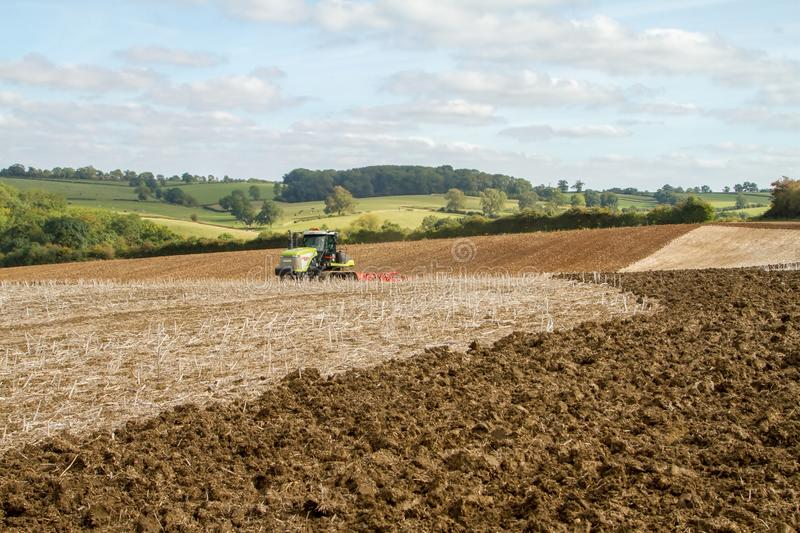 Modern claas tractor cultivating field stock photos