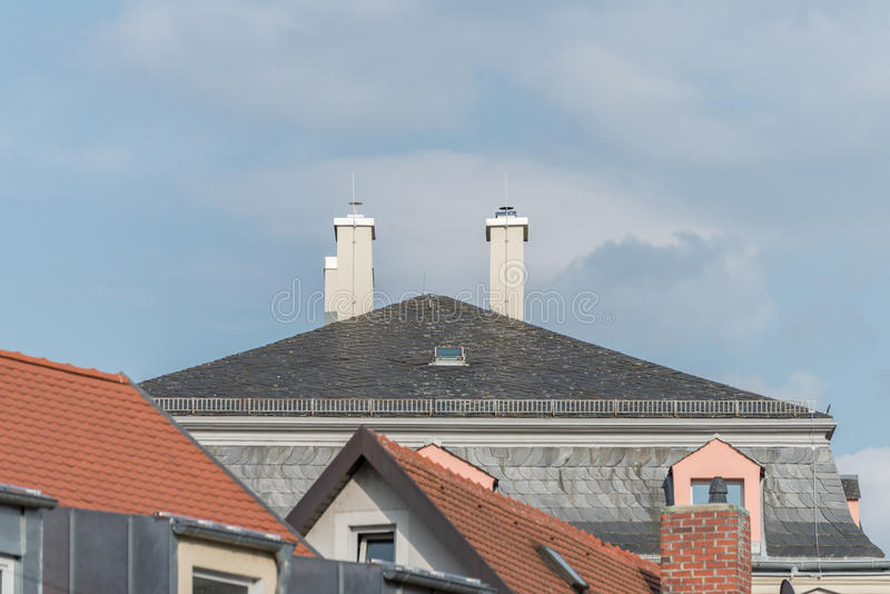 Modern clapboard house with chimney and lightning rod.  stock photography