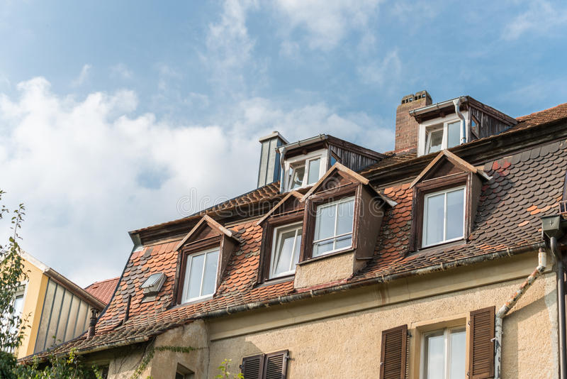 Modern clapboard house with chimney and roof light.  royalty free stock photos