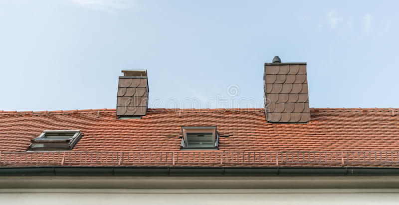 Modern clapboard house with chimney and roof light.  royalty free stock photography