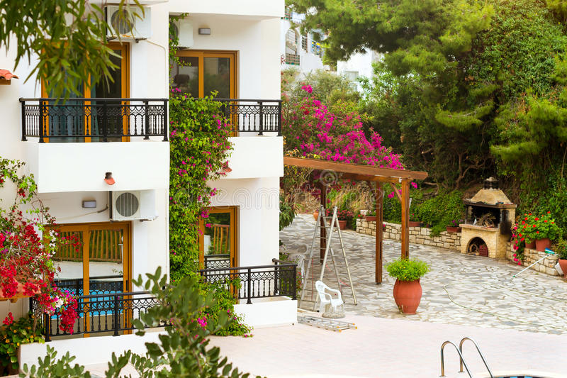 Modern and classic Greek architecture, Village Bali, Crete. Modern and classic resort Greek architecture, new white building in constructivist style, stands on stock photos