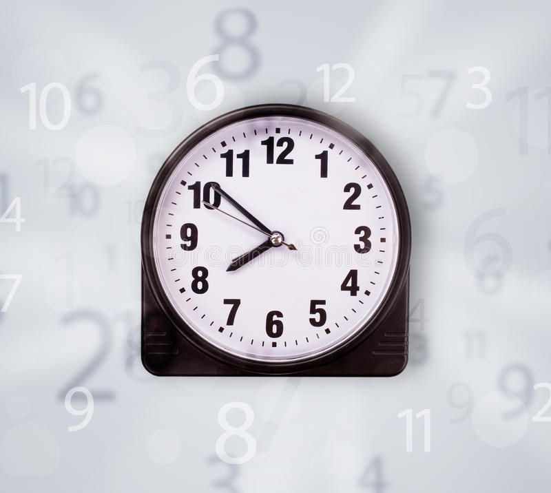 Modern clock with numbers comming out. Modern clock with numbers on the side comming out stock images