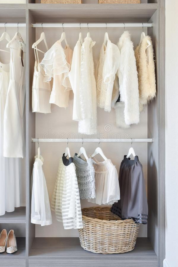 Free Modern Closet With Row Of White Dress And Shoes Hanging In Wardrobe Stock Photography - 111557012