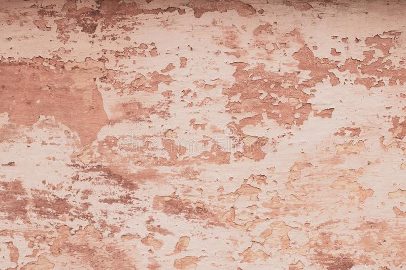 Modern closeup on soft pink backdrop. Old dirty wall texture. Grunge pink texture. Pastel paint texture background. Cracked paint royalty free stock image