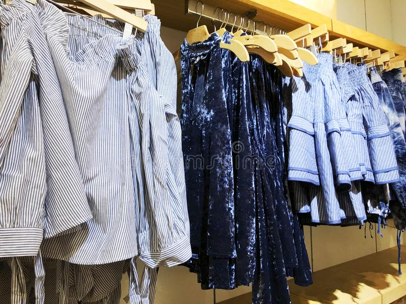 Modern clothes in a shop on a hanger. royalty free stock image