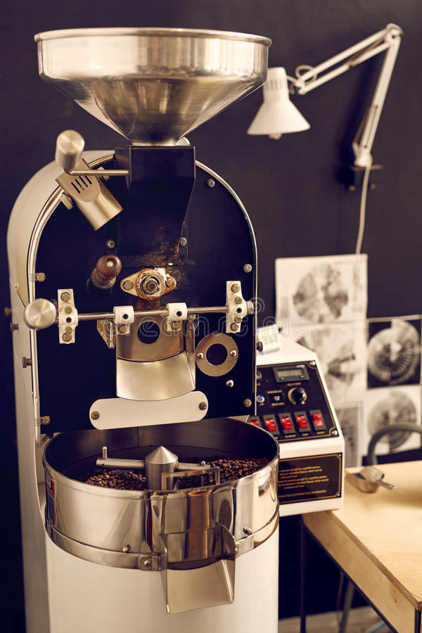 Modern coffee bean roasting machine with shiny metal parts royalty free stock image