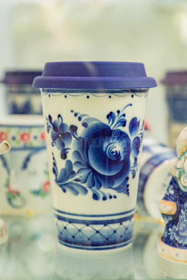 Modern coffee cup to go performed in old russian gzhel style. Blue and white colors royalty free stock photo