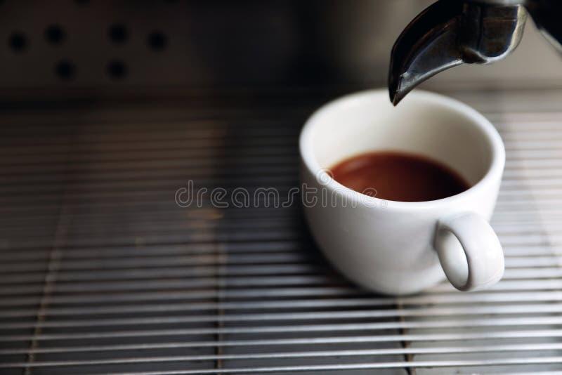 Modern coffee machine with cup on drip tray, closeup stock photos