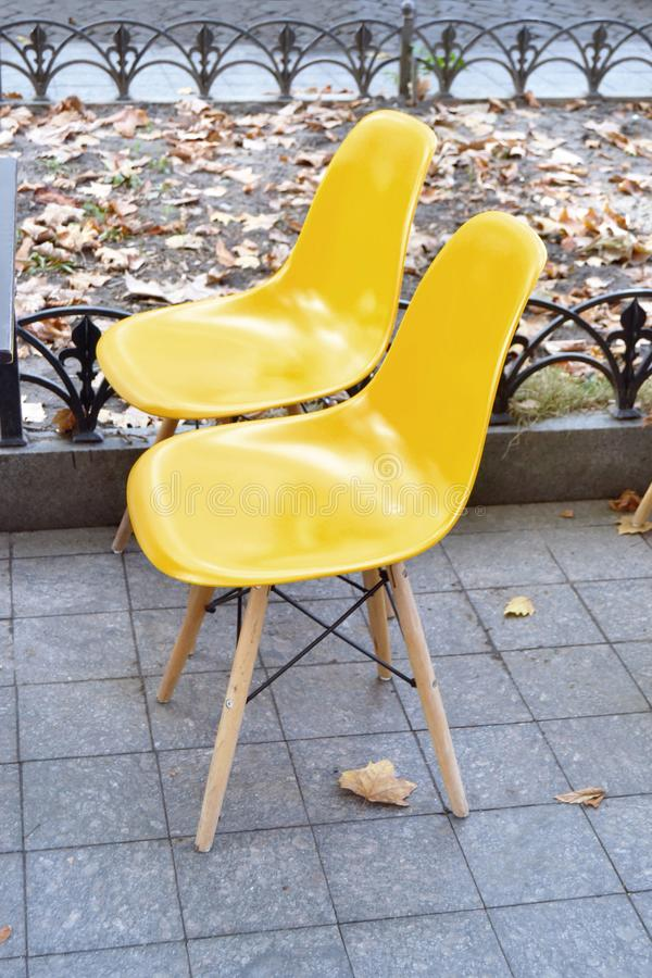 Modern coffee shop plastic chairs royalty free stock images