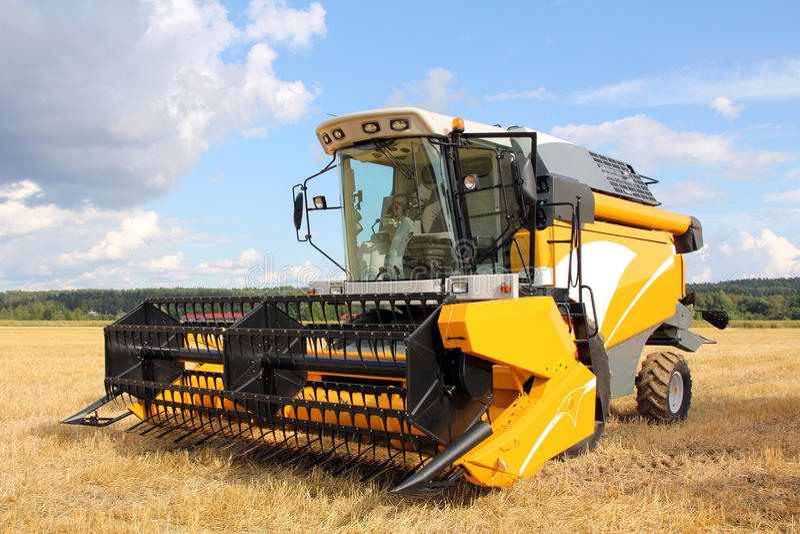 Modern Combine Harvester on Field stock photos