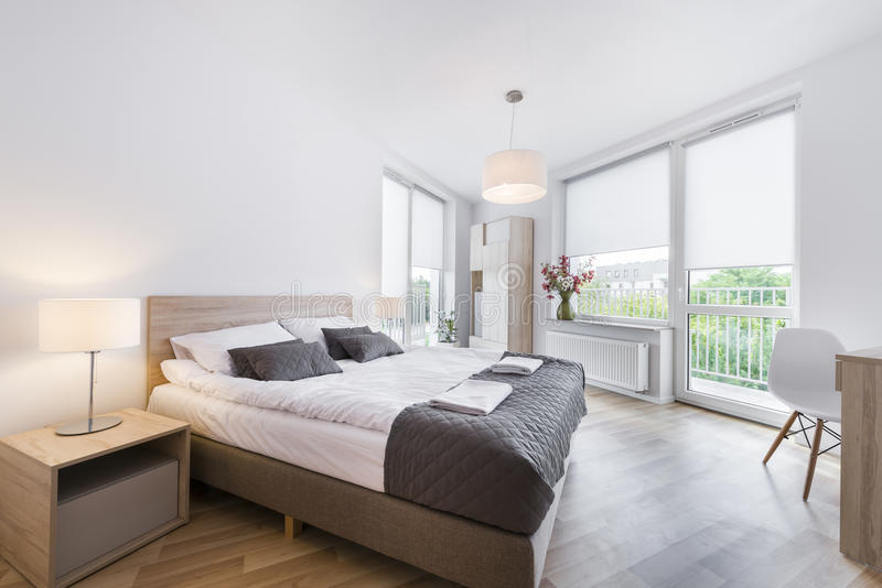 Modern and comfortable bedroom interior design stock image