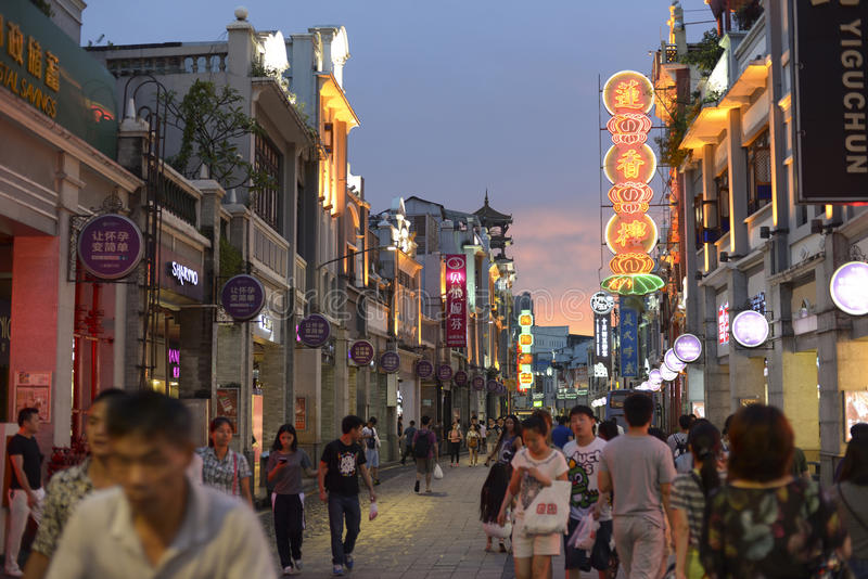 Modern commercial city street, urban shopping street with crowded people, street view of China. Shangxiajiu shopping street in Guangzhou. Urban scenery in China stock photos