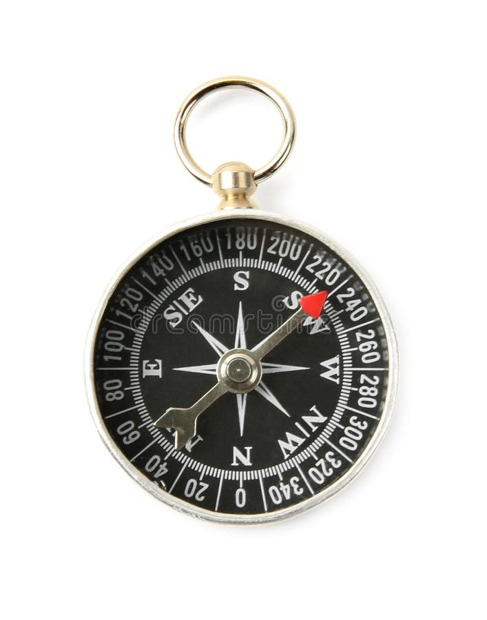 Modern compass on white background. Camping equipment. Modern compass on white background, top view. Camping equipment stock photo