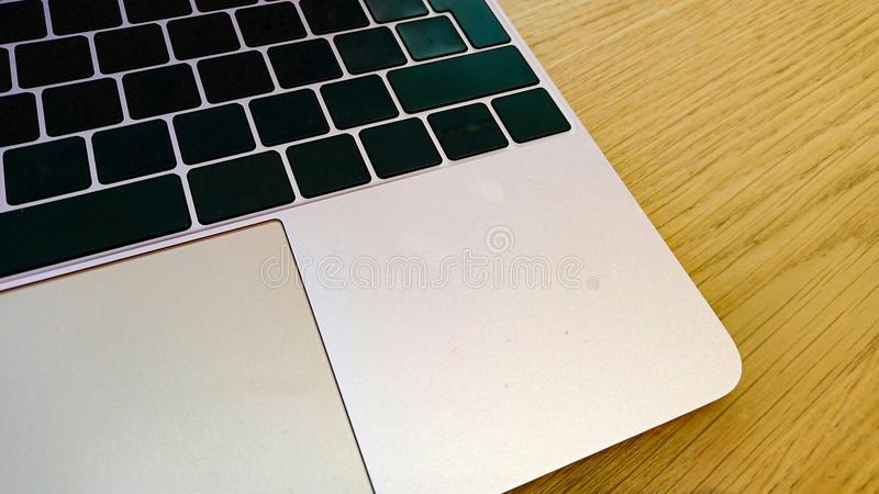Modern computer keyboard and mouse mat with blank keys. A modern portable computer keyboard and mouse pad with blank keys on a wooden surface royalty free stock images