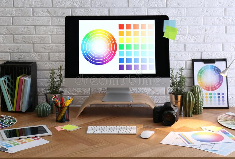 Modern computer and office supplies on table. Designer`s workplace vector illustration