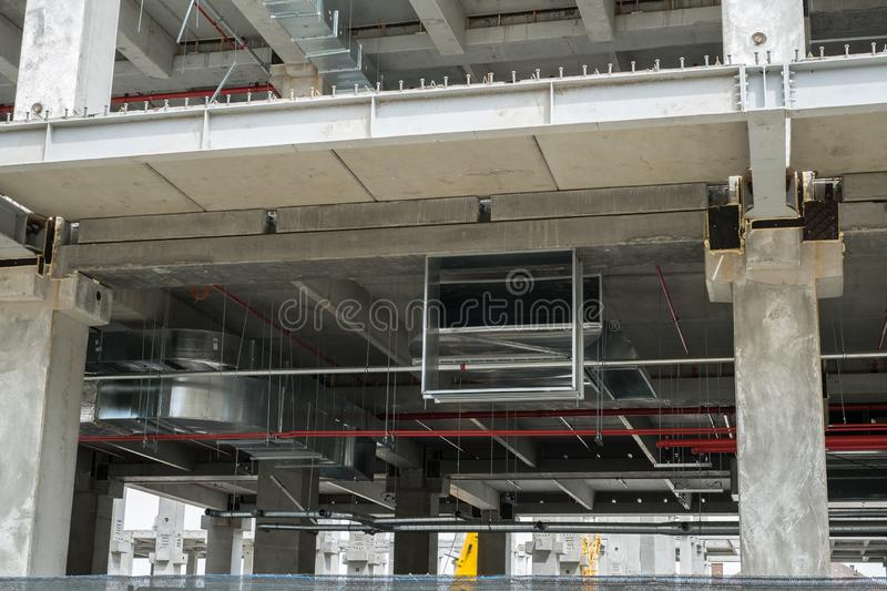 Modern concrete bulding in construction with air conditioning piping stock images