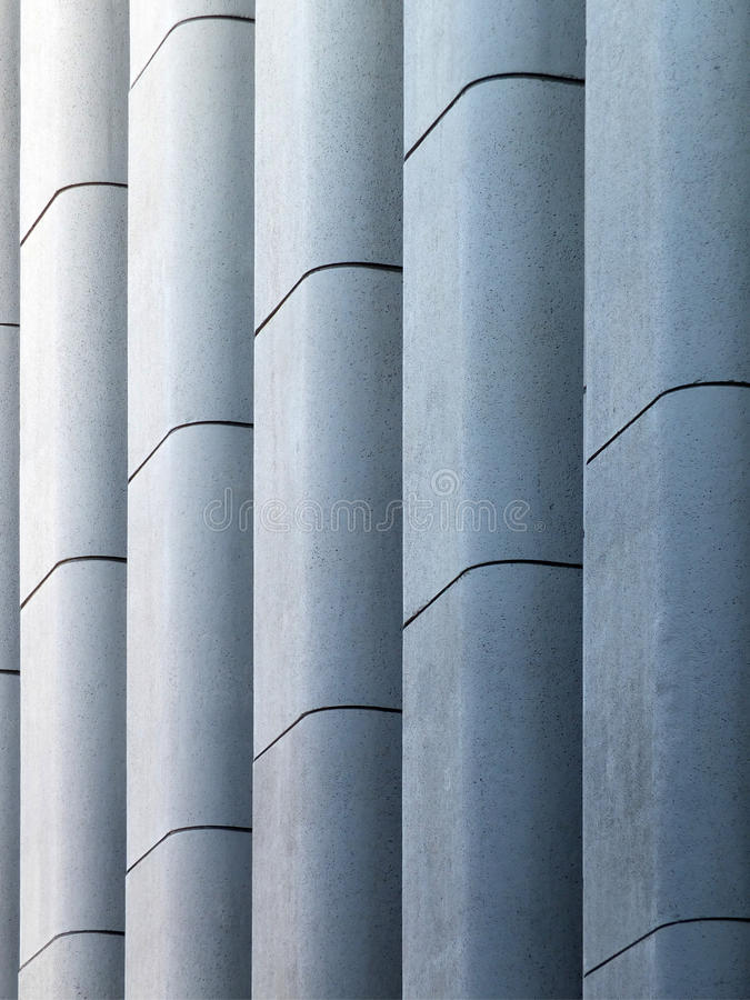 Modern concrete wall. Modern concrete brutalist wall with vertical moulding royalty free stock image