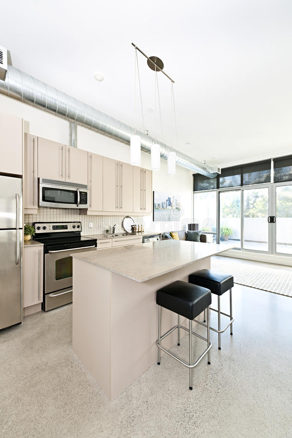 Modern condo kitchen and living room royalty free stock photo