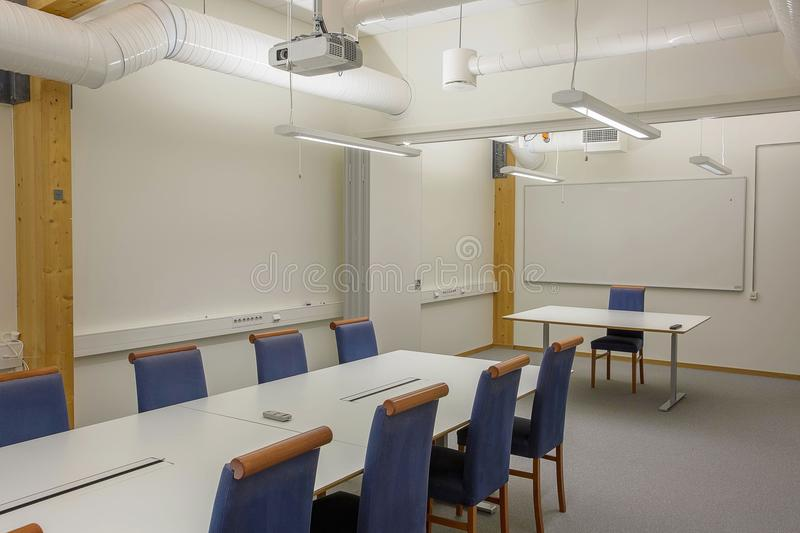 Modern conference / meeting room isolated. White office table and blue chairs. Business concept. Modern office style. stock photos