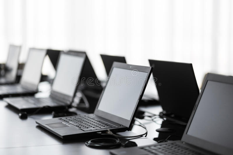 Modern conference room with furniture, laptops, big windows. office or training center interior. Computer Lab royalty free stock images
