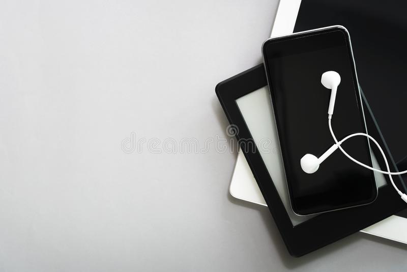 Modern connection technology devices, mobile, tablet, laptop and earphone on table with free space for text. Business and online stock photos